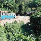 INDIA - Air Conditioned Bus (the windows opened) in the Himalayas, India