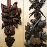 Grinling Gibbons carvings from Hampton Court Palace before restoration (right) and after restoration (left)