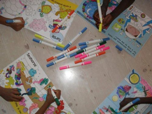 Grade 1s colouring-in their Stick and Learn books