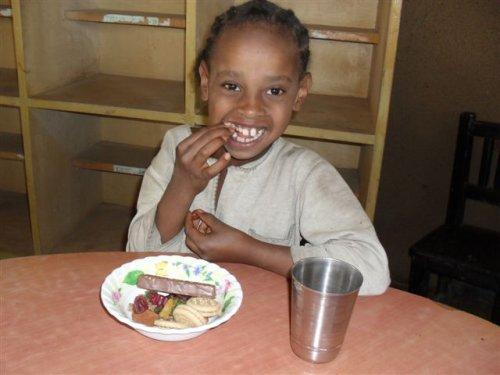 a Grade 2 schoolgirl enjoys her tasty snack