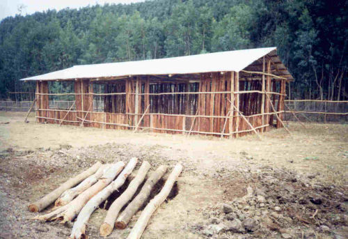 classroom and pit latrine under construction