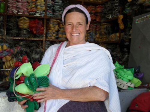 Kate buying schoolchildren's sandals in Gonder