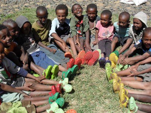schoolboys happy to have new footwear