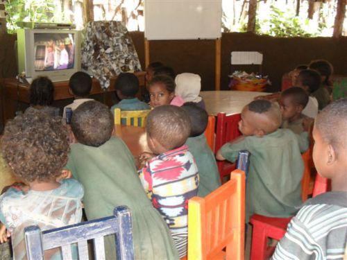 Infants watch a Kidsongs DVD