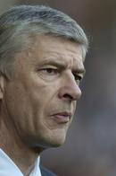 Arsenal manager Arsene Wenger looks on as his team play.