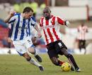Brentfords Lloyd Owusu keeps the ball in a game v Huddersfield.