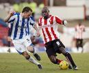 Brentfords Lloyd Owusu keeps the ball in a game v Huddersfield.