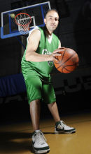 Young basketball player signs for American team.