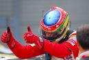 Bruno Senna celebrates win in Ferrari challenge race, Silverstone.