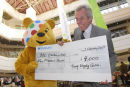 Treaty shopping centre presents cheque to Children in Need.