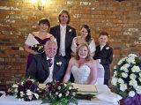 Bride, groom, best man, bridesmaids and page boy